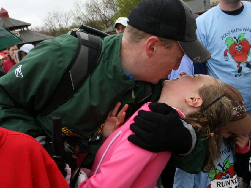Washington Elementary School fifth-grader Clara Kuranz gets a good luck kiss from her father, Steve, before the Education Foundation of Wauwatosa Walk May 9, 2009, at the Milwaukee County Zoo.