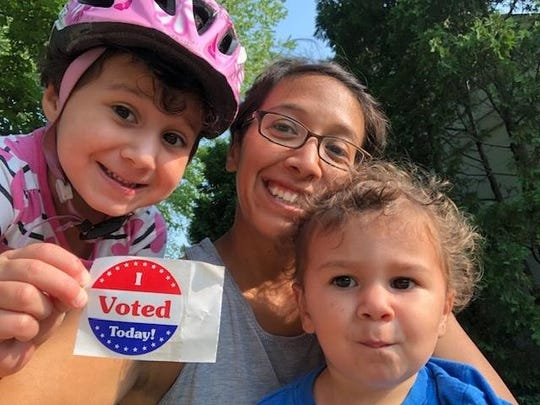 Emily Siegrist took her children, Caroline and Elias, with her to vote in August of 2018.