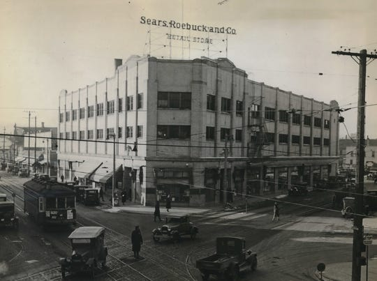 1930: The Sears Roebuck and Co. story at 2100 W. North Ave., at West Fond du Lac Avenue, dominated its bustling commercial neighborhood after it opened in September 1927. This Milwaukee Journal photo, filed in January 1930, shows the store towering over the intersection, with a streetcar heading east on North Avenue and a police officer directing traffic.