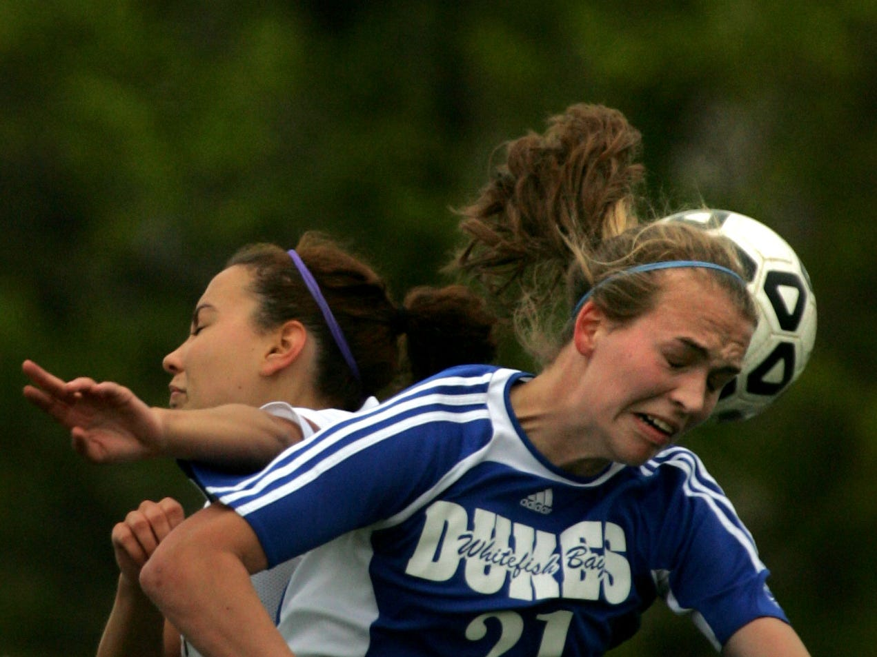 Shorewood's Chelsea Crawford, rear, collides with Whitefish Bay's Abby Starker (21) as the two leap for the header during a game May 9, 2009, at Shorewood High School.