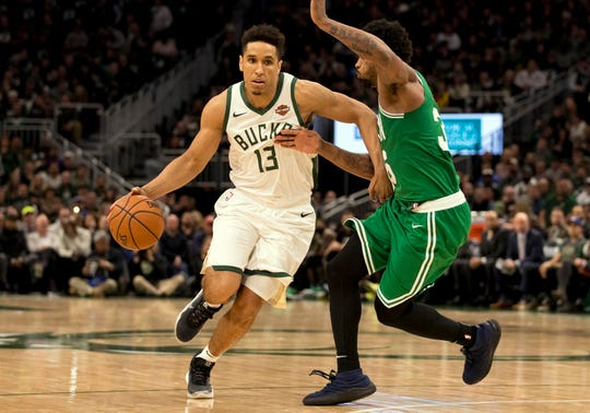 Bucks guard Malcolm Brogdon  drives for the basket against Celtics guard Marcus Smart in the Eastern Conference semifinals.