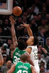 Bucks guard Malcolm Brogdon scores inside Wednesday night in his return.