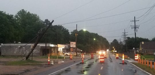 A power pole snapped near its base on South Tenth Street in Monroe as severe weather moved through the area.