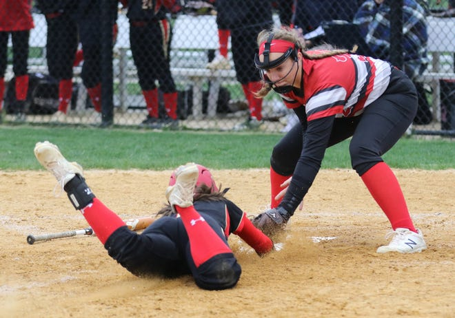 Kaitilin Pettenger of Mt. Olive is tagged out at home by Parsippany pitcher Jenna Devens.
