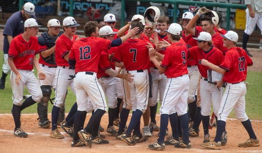 Pike Liberal Arts' Chandler Golden (7) is congratulated on hitting a home run as Pike defeated Morgan Academy in the AISA AAA State Championship game at Riverwalk Stadium in Montgomery, Ala., on Thursday May 9, 2019.