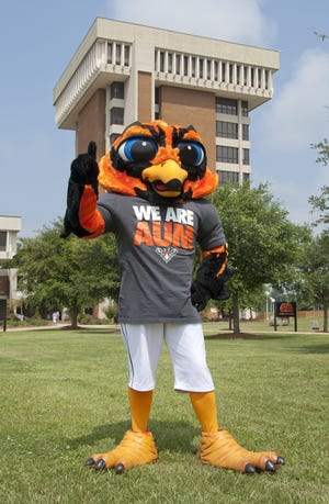 AUM mascot Curtiss stands in front of the iconic Ida Belle Young Library Tower on the AUM campus.