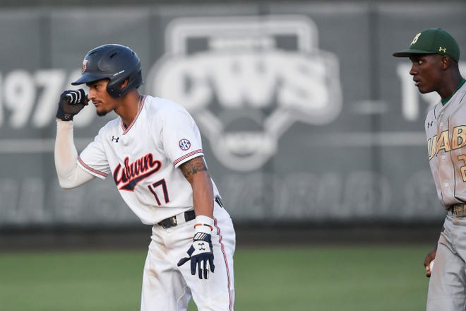 Auburn's Will Holland (17) celebrates after getting a hit against UAB on Tuesday, May 7, 2019, in Auburn, Ala.