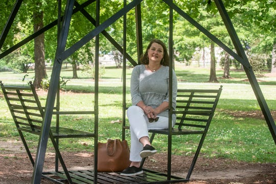 Jacque Foshee, executive director of Montgomery Botanical Gardens, sits on one of their new iron gliders, replicas of the park's original wooden ones. The public is invited to activities at Montgomery Botanical Gardens in Oak Park during National Public Gardens Week on May 13-19, 2019.