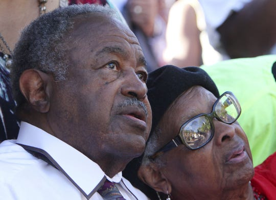 "Chris and Maxine McNair, the parents of of Denise McNair, watch as the sculpture is revealed at the unveiling ceremony for ""The Four Little Girls,"" a sculpture memorial honoring Addie Mae Collins, Denise McNair, Carole Robertson and Cynthia Wesley in Birmingham, Ala. Chris McNair, the father of one of four young girls killed in the 1963 bombing of a Birmingham church, died Wednesday, May 8, 2019. He was 93."