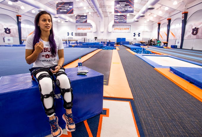 Auburn university gymnast Sam Cerio is seen in the women's gymnastics practice facility on the AU campus in Auburn, Ala., on Thursday May 9, 2019. Cerio, who recently graduated with a degree in aerospace engineering, dislocated both of her knees and ruptured multiple ligaments in her legs during an NCAA regional semifinal meet.