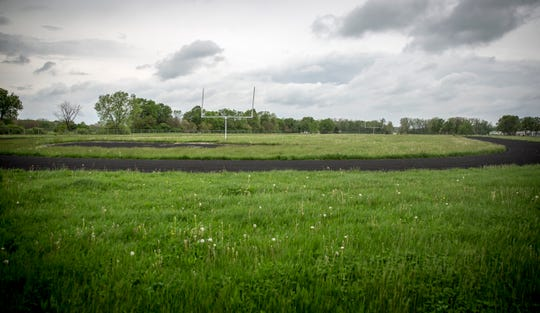 A vacant football field and track that was part of the old Wilson Middle School will be part of the Bison Ridge development if it goes through. Developers have said they will integrate the track into the development at the request of the public.