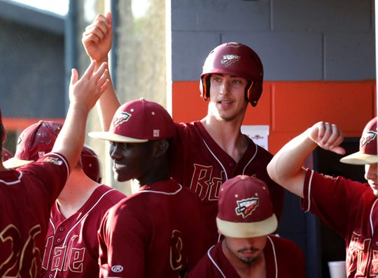 Riverdale's Brayden Siren (19) is congratulated in the dugout after getting a base hit and advancing runners during the District 7-AAA Baseball Championship game against Blackman on Wednesday, May 8, 2019, at Blackman.