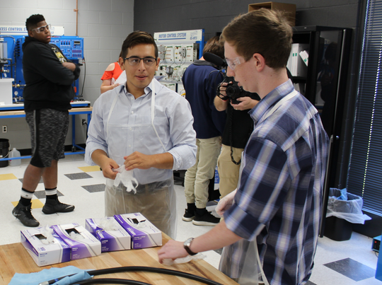 Mario Pukl works with classmates in the Mechatronics program at Fairview High School.