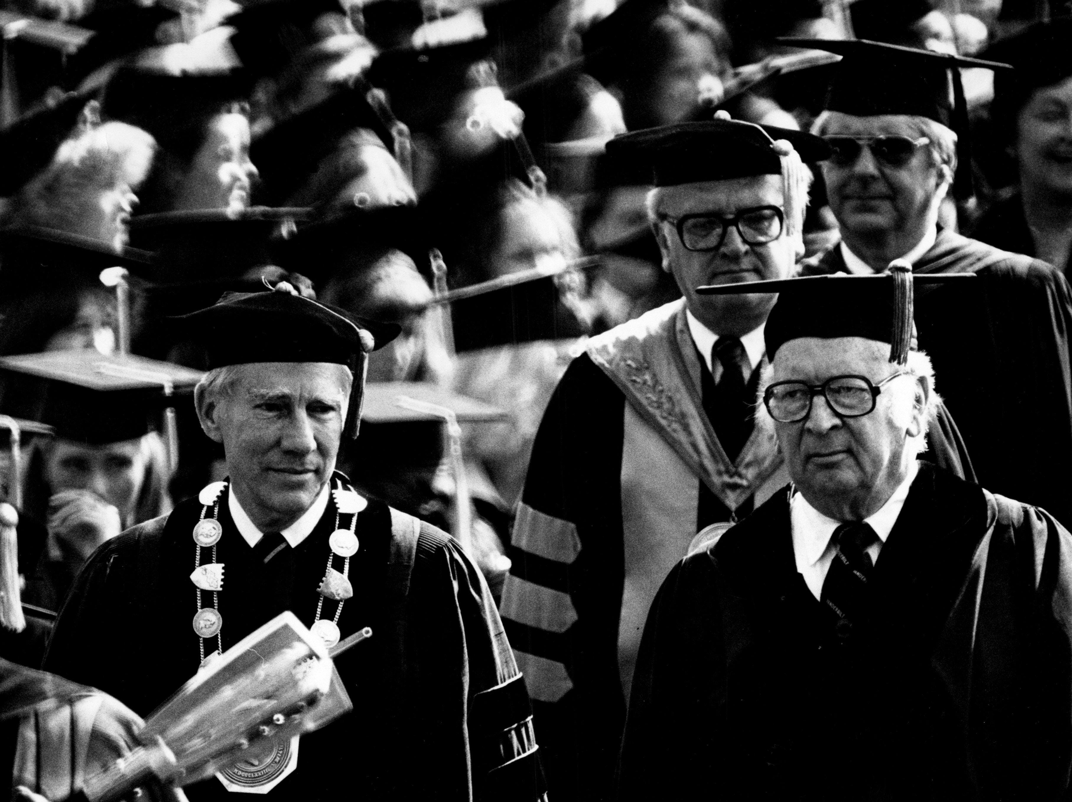 Alexander Heard, left, accompanied by David K. Wilson, chairman of the Vanderbilt University board of trust, and followed in procession by President Emmett B. Fields, marches toward his final commencement exercises as Vanderbilt chancellor in 1982..