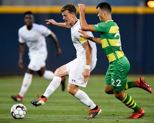 Nashville SC midfielder Michael Reed (17) battles Tampa Bay Rowdies midfielder Jordan Doherty (22) during the first half at First Tennessee Park in Nashville, Tenn., Wednesday, May 8, 2019.