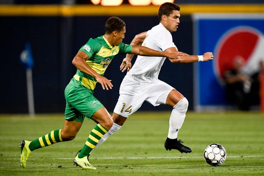 Nashville SC forward Daniel Rios (14) battles Tampa Bay Rowdies midfielder Caleb Richards (20) during the first half at First Tennessee Park in Nashville, Tenn., Wednesday, May 8, 2019.