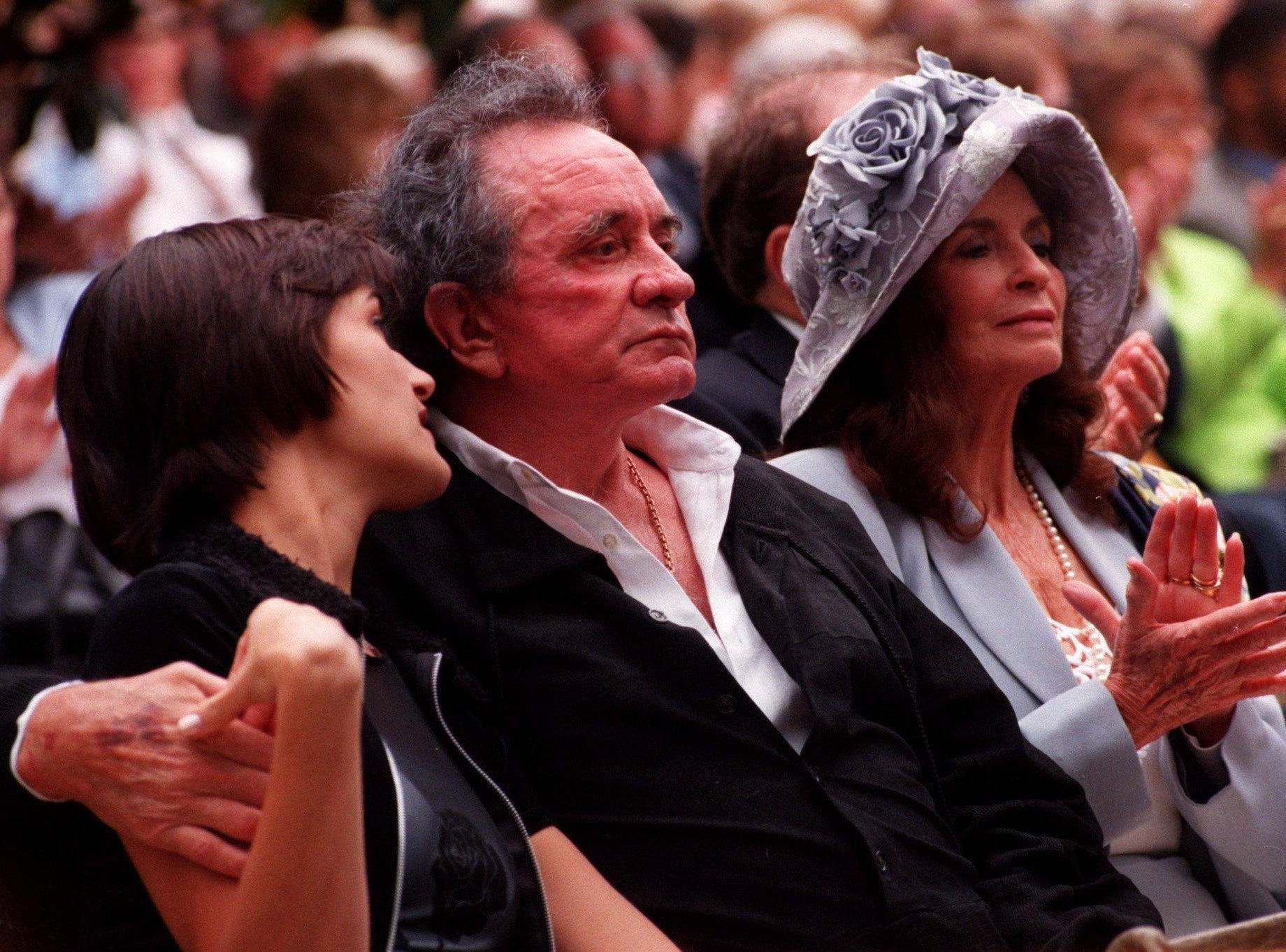 Johnny Cash, June Cash and their granddaughter Tiffany Lowe attend Vanderbilt's 1996 graduation to watch their grandson Jackson Routh receive his degree.