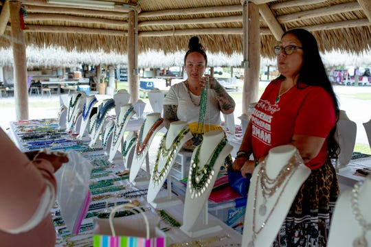 Dakota, left, and Tina Osceola sell jewelry together at the Osceola Village on the Miccosukee reservation on May 5, 2019. The mother and daughter make jewelry individually and often sell it together at events and locations across Southwest Florida.