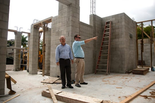 Mark Borelli and his son Parker Borelli tour a home they are  building, Thursday, May 9, 2019 at the Estuary at Grey Oaks community in Naples.