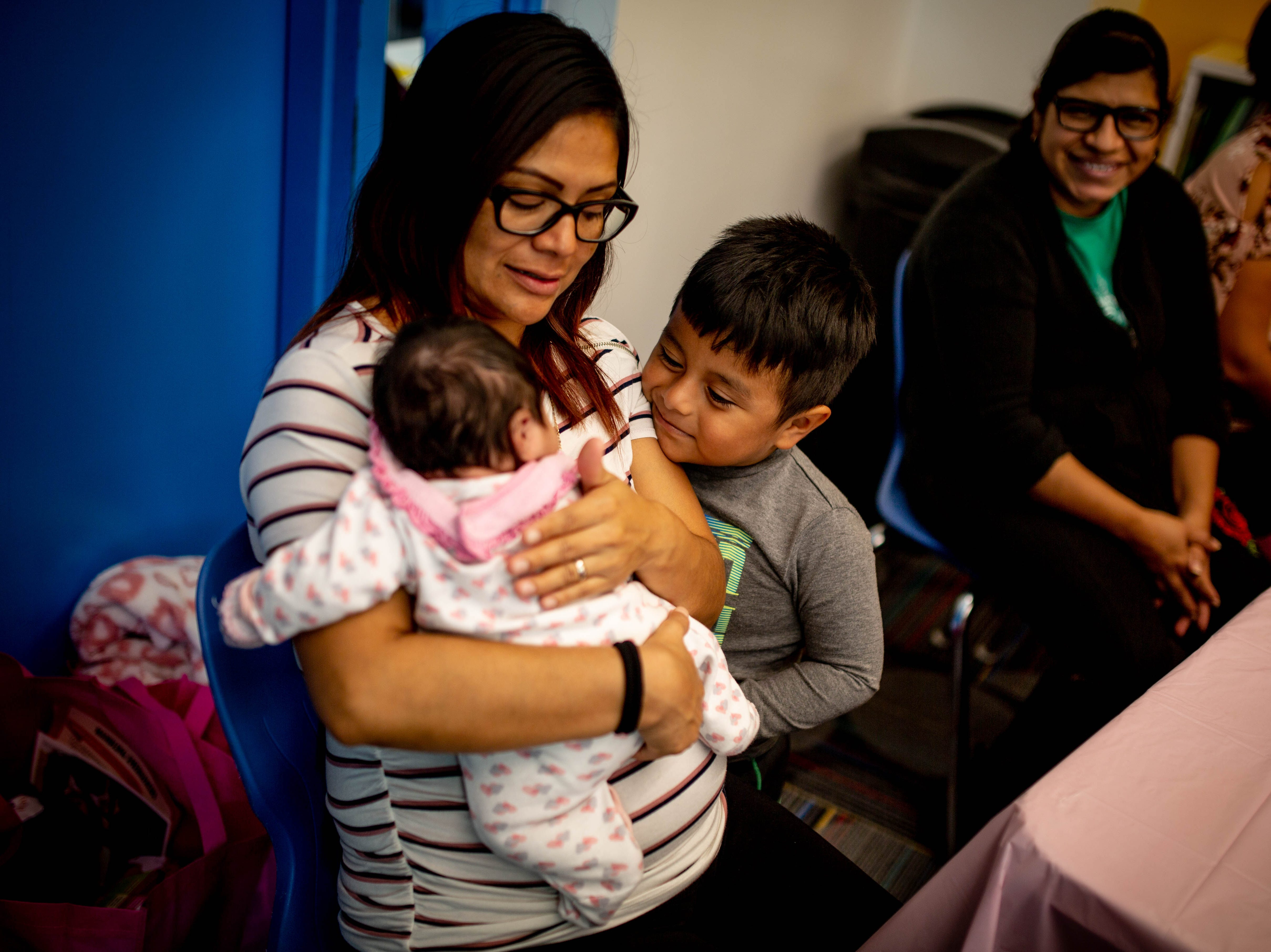 Francisca Herrera and her son Nicolas attend the Immokalee Community Baby Shower at the Boys & Girls Club in Immokalee on Thursday, May 9, 2019.