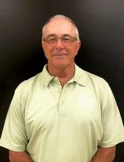 Mike Olayos, St. John Neumann track coach