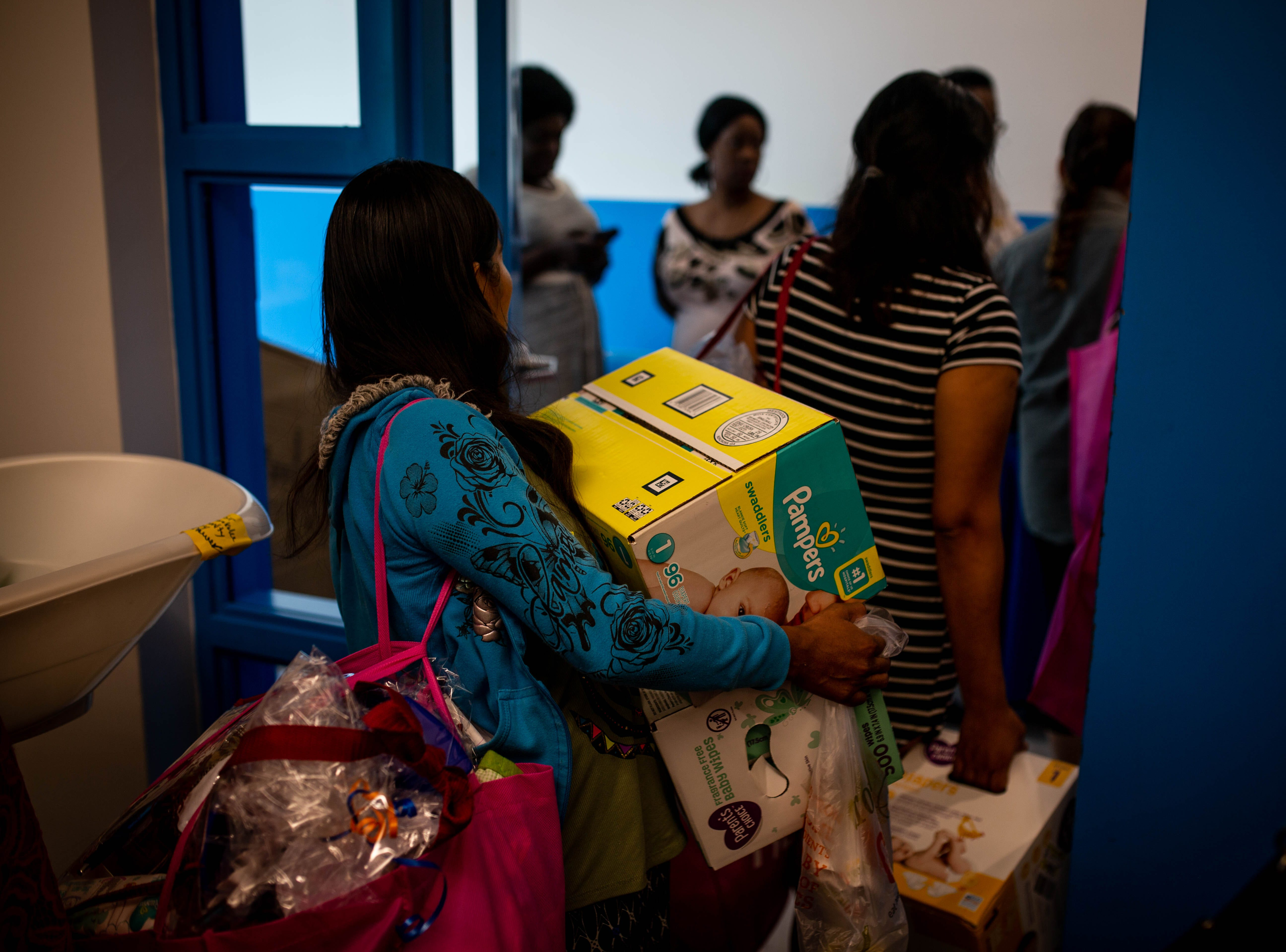 At the end of the shower, attendees leave with their gifts at the Immokalee Community Baby Shower at the Boys & Girls Club in Immokalee on Thursday, May 9, 2019.