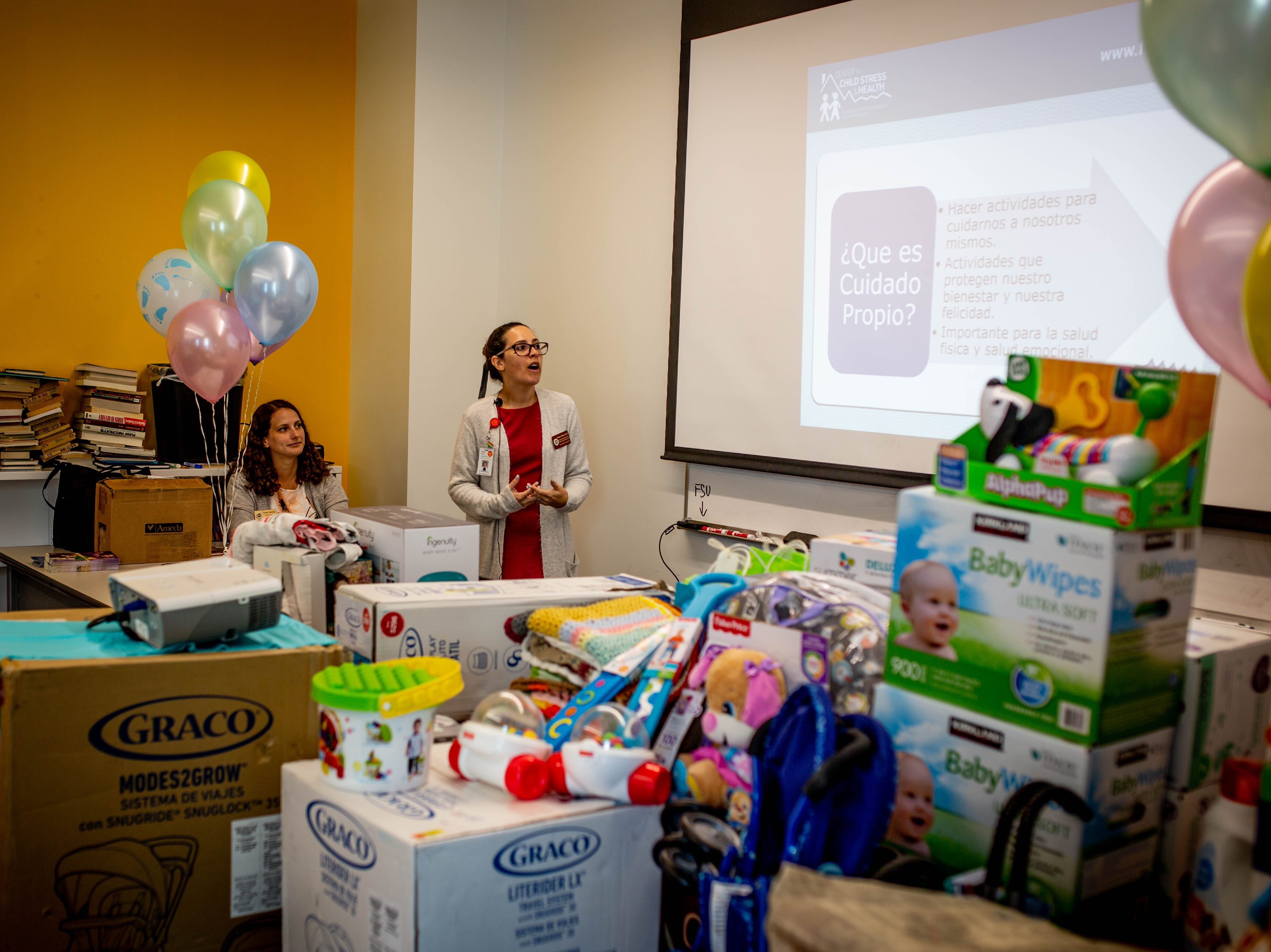 Dr. Adriana Ziemba gives a presentation at the Immokalee Community Baby Shower at the Boys & Girls Club in Immokalee on Thursday, May 9, 2019. Presentations on prenatal and postnatal care were given in both Spanish and English.