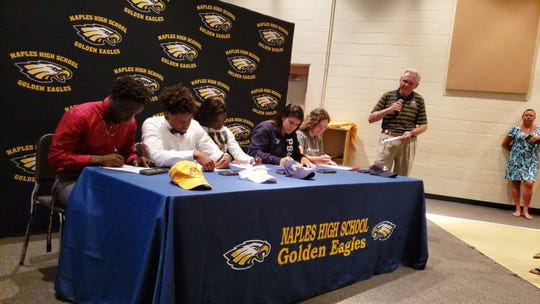 Five Naples High School athletes sign letters of intent to play in college during a ceremony on Wednesday. L to R: Smidley St. Louis (football, Minnesota-Crookston), Handel Victor (lacrosse, Keystone College), Merlica Faustin (track, FIU), Priscilla Medal (volleyball, Penn State-Beaver), and Shelby Weinberg (lacrosse, Akron)