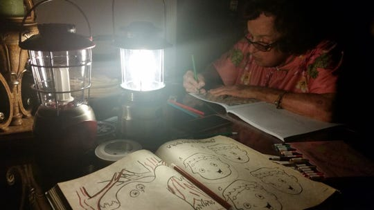 When Hurricane Irma reached Miami-Dade County and knocked out the power, Blanca and Alexi Cardona colored by lantern light.