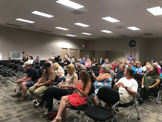 Residents gathered at a town hall meeting at the University of Florida/IFAS Collier County Extension Office in Golden Gate Estates to hear presentations from the groups interested in buying county property along Immokalee Road, across from the Publix on Randall Boulevard, on Wednesday, May 8, 2019.