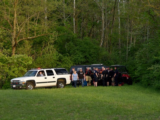 Newark police investigate after a body was discovered around 6 p.m. on Wednesday, May 8, 2019, in Raccoon Creek near North 21st Street.