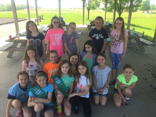The Granville Girl Scouts gathered May 8 at Granville Intermediate School to complete their project to benefit the Newark YMCA special needs preschool program.