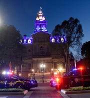 Local law enforcement agencies from across Licking County gathered to light the Licking County Courthouse blue to kick off National Police Week on Wednesday, May 8, 2019. National Police Week runs from May 8-16.