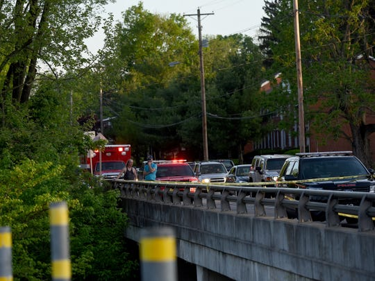 Newark police investigateafter a body was discovered around 7:08 p.m. on Wednesday, May 8, 2019, in Raccoon Creek near North 21st Street.