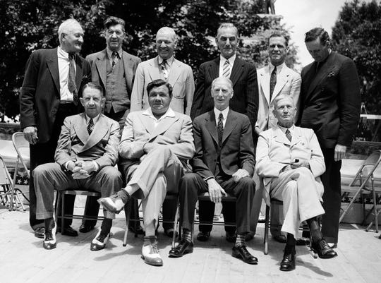 These old time ball stars were pictured as they attended the dedication of the baseball Hall of Fame on Main Street here on June 12, 1939. The ceremony which was held in connection with the bi-centennial celebration taking place here. They had all won election to the Hall of Fame and their busts are on view in the building along with those of immortals of the game. Front row; Eddie Collins, Babe Ruth, Connie Mack, Cy Young; Rear row left to right; Hans Wagner, Grover Cleveland Alexander, Tris Speaker, Napoleon Lajoie, George Sisler and Walter Johnson. (AP Photo)