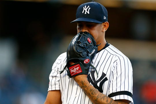 May 8, 2019; Bronx, NY, USA; New York Yankees starting pitcher Jonathan Loaisiga (43) reacts walking back to the dugout against the Seattle Mariners during the first inning at Yankee Stadium.