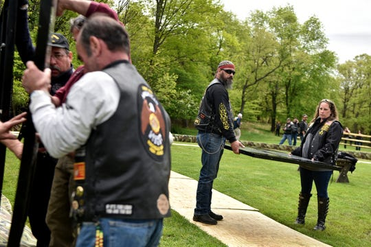 The Moving Wall, the traveling half-size replica of the Vietnam Veterans Memorial, is set up in Garret Mountain Reservation in Woodland Park on Thursday, May 9, 2019. Greg and Heather Wiebe hold a panel waiting to be installed in the memorial.