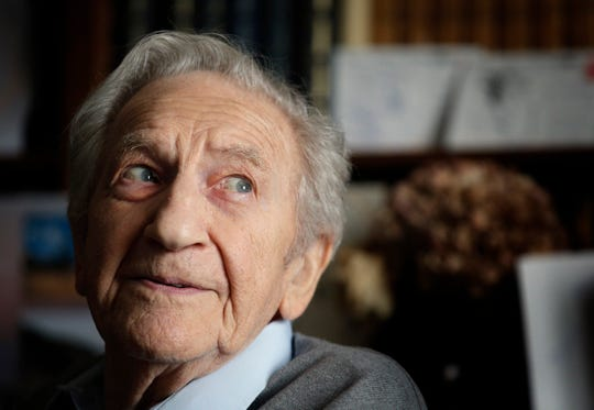 In this photo taken on Thursday May 8, 2014, Bernard Dargols poses during an interview with the Associated Press at his home in La Garenne-Colombes, outside Paris. Dargols waded onto Omaha Beach in June 1944 as an American soldier to help liberate France from Nazis who persecuted his Jewish family. At 98, Dargols died last week. An ever-smaller number of D-Day veterans will take part in June 6, 2019 ceremonies marking the 75th anniversary of history's largest amphibian invasion.
