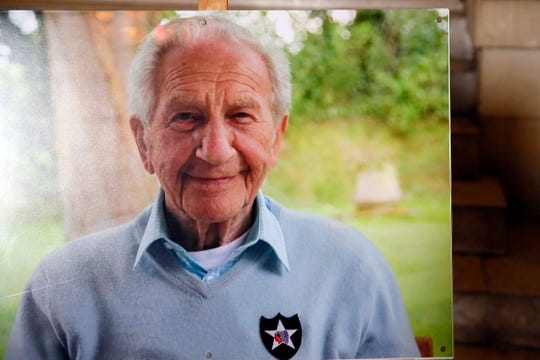 In this family handout photo, a portrait of late Jewish French-American World War II veteran, Bernard Dargols, wearing the logo of the 2nd Infantry Division on his sweater, is displayed during his funeral ceremony at the Pere Lachaise cemetary in Paris, Thursday, May 9, 2019. Dargols waded onto Omaha Beach in June 1944 as an American soldier to help liberate France from Nazis who persecuted his Jewish family. At 98, Dargols died last week. An ever-smaller number of D-Day veterans will take part in June 6 ceremonies marking the 75th anniversary of history's largest amphibian invasion.