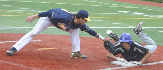 Saddle Brook first baseman Nick Cerbo tagging North Arlington's Tony Alho, who slides back to first safely during the NJIC Meadowlands Division battle May 6.
