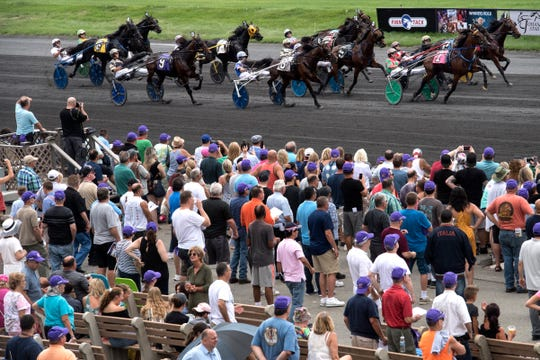 FILE -- This photo from Aug. 4, 2018 shows the start of the sixth race during Hambletonian Day at the Meadowlands.  On Thursday, May 9, 2019,  the Hambletonian Society and the Meadowlands Racetrack signed a 2-year contract extension and set up a new race format for 2020.