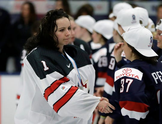 FILE - In this April 7, 2017, file photo, Canada goalie Shannon Szabados, left, greets United States forward Amanda Pelkey (37)  after overtime of the gold-medal game of the women's world hockey championships, in Plymouth, Mich. On Wednesday, May 8, 2019, the owner of the Buffalo Beauts has given up control of the National Women's Hockey League franchise. This further jeopardizes the league's future as it struggles to keep its five franchises afloat, and without the support of the world's top players. On Thursday, the NWHL learned it will have difficulty restocking its rosters after more than 200 of the world's top female players pledged they'll not compete professionally in North America next season.