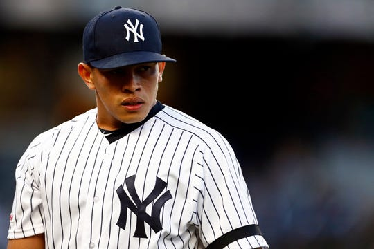 May 8, 2019; Bronx, NY, USA; New York Yankees starter Jonathan Loaisiga (43) reacts as he walks back to the dugout after pitching against the Seattle Mariners in the fourth inning at Yankee Stadium.