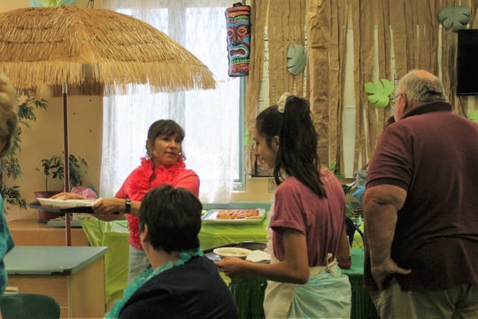 Mountain View Middle School Culinary Arts teacher Annette Joyner helps her class serve Alamogordo Public Schools faculty and staff at their annual SOUPer lunch for Teacher Appreciation Week. This year's theme was a Hawaiian luau.