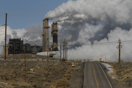 Steam billows from the San Juan Generating Station in January 2013 in Waterflow.