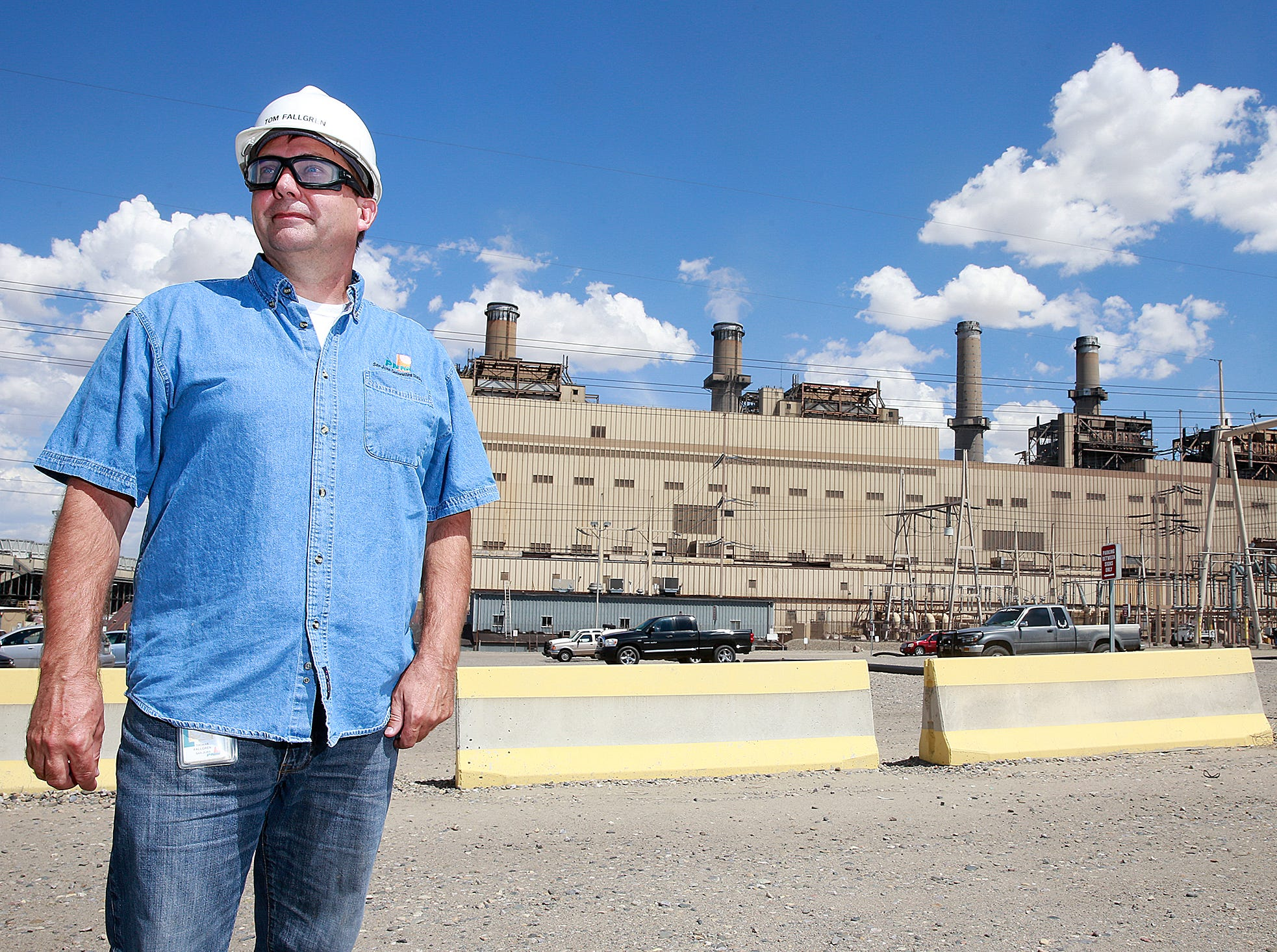 Tom Fallgren, plant manager at the San Juan Generating Station, stands near the power plant, Monday August 1, 2016, in Waterflow.