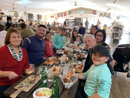 A family enjoys lunch at Hunt & Harvest in midtown Ruidoso at the corner of Sudderth Drive and Eagle Drive.