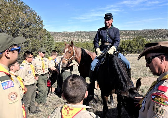 Troop 180 met Matt Midgett and his horses at the Fort Stanton Cemetery.