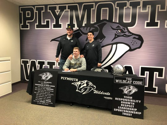 Plymouth's Luke Fisher will be a preferred walk-on at Michigan. He's pictured here with Plymouth head coach Brian Lewis (left) and offensive line coach Cory Zirbel (right).