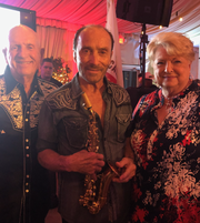 From left: Walt and Judy Van Benthuysen, co-founders of the local chapter of American Friends of our Armed Forces, with Lee Greenwood (center).